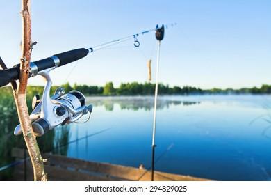 Morning fishing with spinning on lake