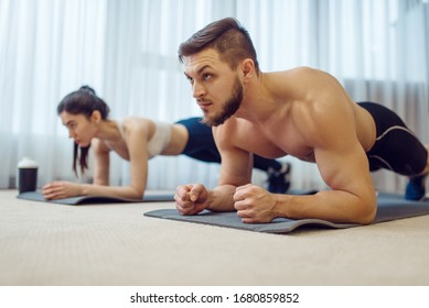 Morning fitness workout of family couple at home
