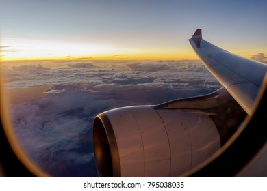 Morning flight on twilight sky, view from the window plane.