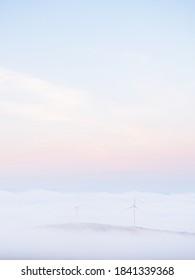 Morning fog covering the windmills near Mount Wachusett in Massachusetts