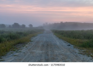 Morning fog hovers above a rural road in Appalachia.