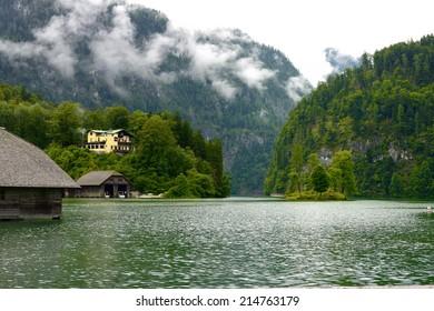 Morning fog lake Koenig in the german Alps near Berchtesgaden