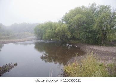The morning fog on the river Ignashino Amurskaya oblast The Far East of Russia.