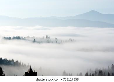 Morning fog on the slopes of the Carpathian Mountains (Yablunytsia village, Ivano-Frankivsk oblast, Ukraine).