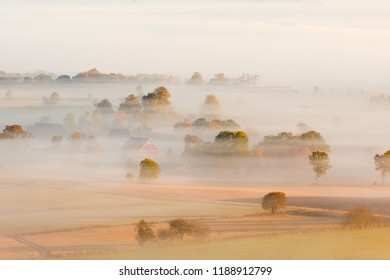 Morning fog over the fields and farms in the countryside