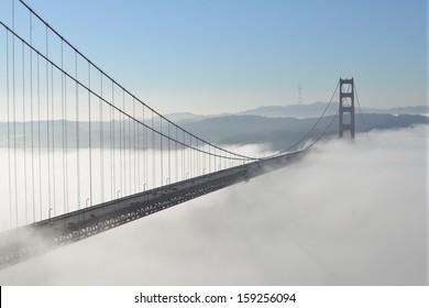 Morning fog passing under the Golden Gate Bridge