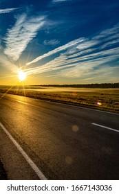 Morning fog streak along the highway at sunrise