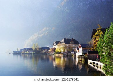 Morning foggy light over Hallstatt Lake in Salzkammergutt, Austria, Europe