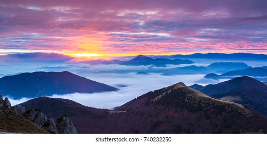 Morning fogs in the mountains with sunrise