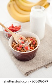 Morning granola breakfast with raisins and hazelnut served with milk