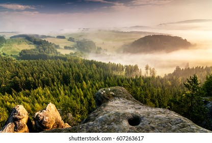 Morning hazy landscape under Cross Hill, Adrspach - Teplice rocks, Czech republic, Europe.