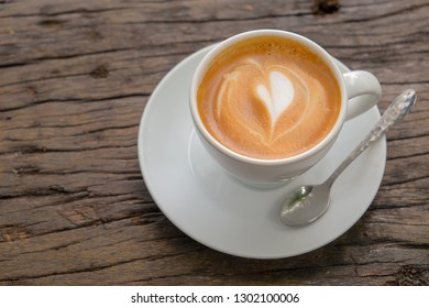 Morning hot cappuccino coffee on vintage wooden