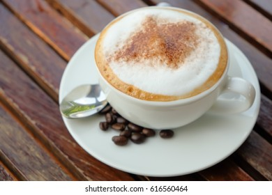 Morning, Hot cappuccino coffee on wooden table