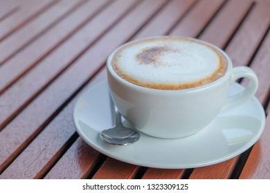 Morning hot coffee on wooden table