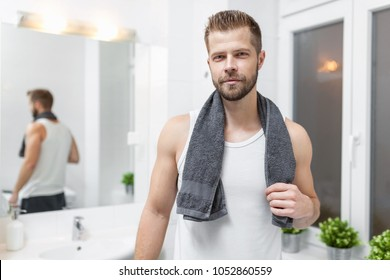 Morning hygiene, Handsome man in the bathroom looking in mirror