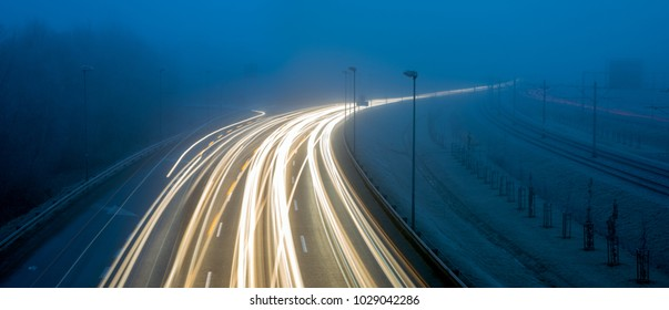 morning, intensive traffic on the urban road thoroughfare in difficult road conditions, fog and darkness