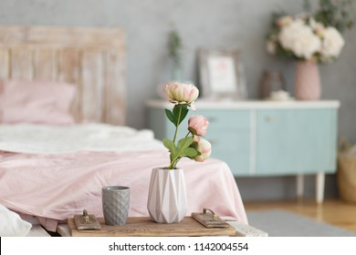 Morning interior in the bedroom of the girl, vase with flowers, breakfast in bed