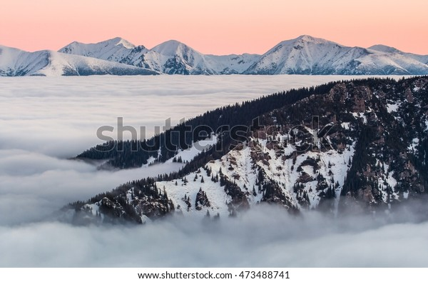 Morning inversion at dawn in Slovak mountains.