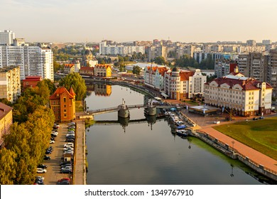 Morning in Kaliningrad. River Pregolya, Embankment of the Fish Village and the Jubilee Bridge. Russia, Kaliningrad