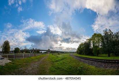 Morning landscape in the city. Beautiful sky with massive clouds. Panorama.