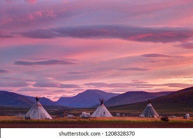 Morning landscape with dwellings of nomadic reindeer herders at sunrise. Russia
