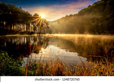 Morning landscape with misty at the lake, Majestic sunrise or sunset in the mountains with tourists camping at the lake with foggy in the morning,  Pang Ung, Mae Hong Son, Thailand.