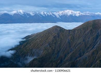 Morning landscape with a mountain range in the snow. Caucasus, Georgia, Zemo Svaneti