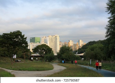 Morning Landscape of Tancheon riverside in Bundang, South Korea-Oct. 1, 2017 : Many people are taking a walk along the river. On the back of the picture, there are apartments and NAVER building.