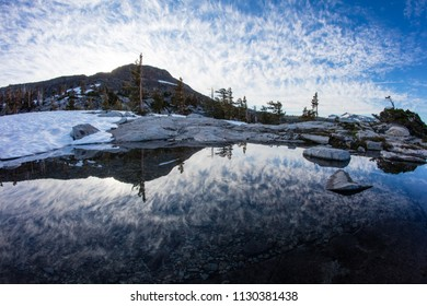 Morning light illuminates high mountain scenery in California's Desolation Wilderness, not far from Lake Tahoe. This beautiful part of the Sierra Nevada Mountains is popular for camping and hiking.