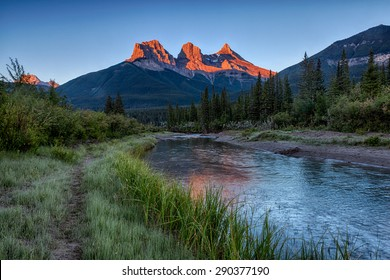 Morning light just hitting the top of the Three Sister peaks near Canmore, Alberta, Canada