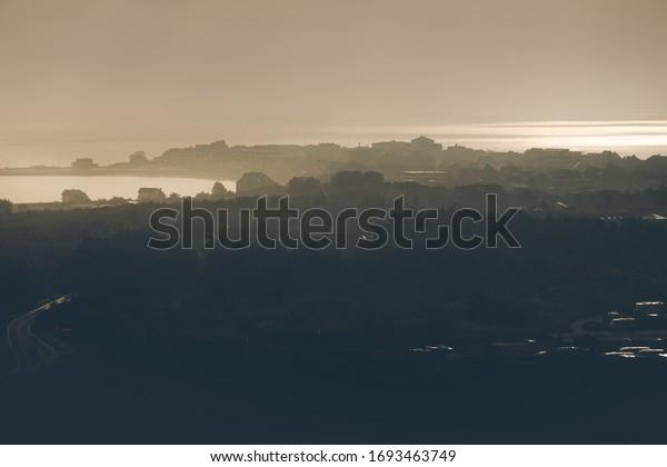 Morning light on the horizon - the island of Amrum in the awakening