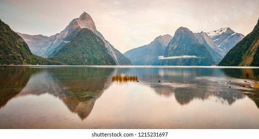 Morning light on Mitre Peak and surrounding mountains at Milford Sound, Fiordland, in New Zealand's South Island.