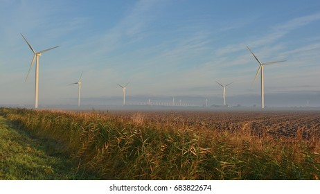 Morning light on the Oosterscheldekering. Seen from the farmland of Noord-Beveland. Province: Zeeland, Country: Netherlands