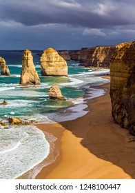 Morning light on the Pacific coast near Melbourne. Famous rocks Twelve Apostles in ocean waves surf. The concept of active and phototourism