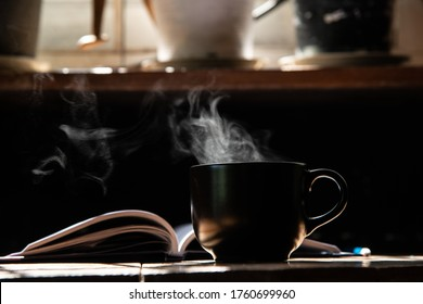 morning light refresh with black cup coffee aroma stream and wirting diary on wood table stock photo