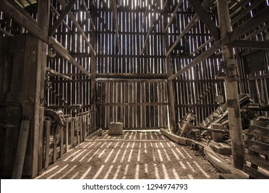Morning Light. Morning sunlight illuminates the interior of a barn. This is a barn open to the public on national park lands, it is not a privately owned property.