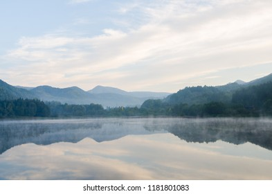 Morning lights above the lake in the Transylvanian mountains