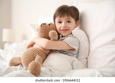Morning of little boy in bedroom