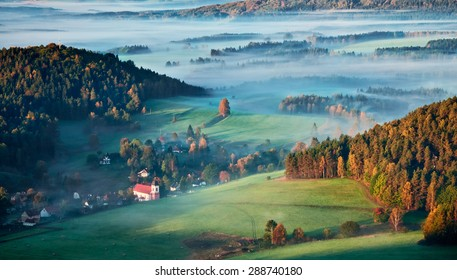 Morning mist above meadows around Jetrichovice in Czech Switzerland national park.