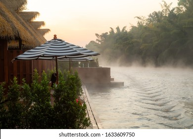 Morning mist above river among the forest at River Kwai floating resort