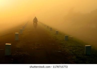 morning mist in the cengklik reservoir in central java Indonesia