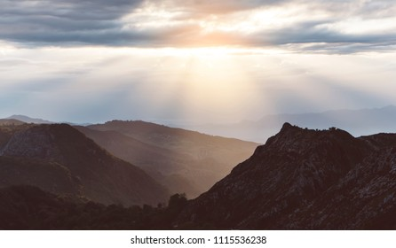 morning mist in the mountain peaks on natural landscape. Green valley on background foggy dramatic sky. Panorama horizon perspective view of scenery hills Northern Spain mountain tops. Travel mockup
