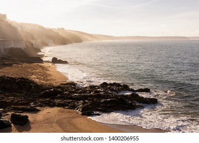 Morning mist on the cliffs along Porthleven Sands in Cornwall, England, UK.