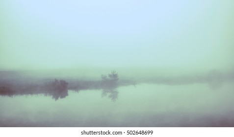 Morning mist on a lake. Infrared filter.