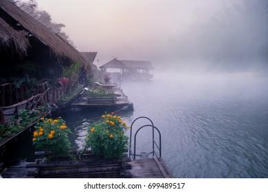 Morning mist from the rafts in river Kwai, Kanchanaburi, Thailand