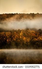 Morning Mist, Sunrise over Scarlet Oak Lake in Autumn.