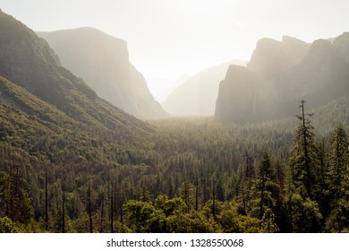 Morning mists burn off across the Yosemite Valley of the Sierra Nevada Mountains in Yosemite national Park, California.