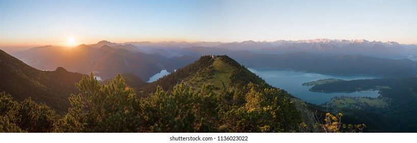 morning mood at martinskopf mountain, with rising sun and view to bavarian alps