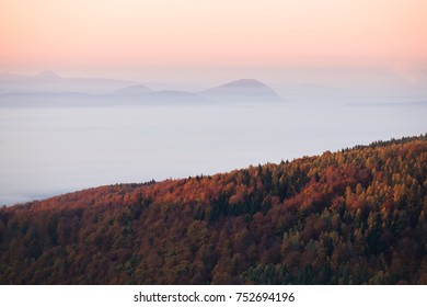 Morning mood over a foggy autumn landcape in the mountains