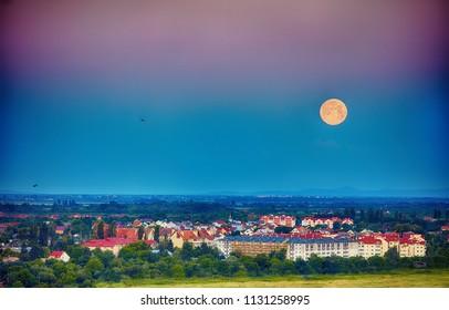 morning moon over the city in the valley. Uzhhorod, Ukraine